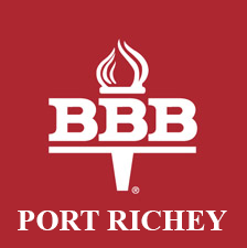 Better Business Bureau Logo , has a torch and the background is red with the words Port Richey