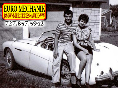 Photo of a couple hugging on an old european car with Euro Mechanik Logo