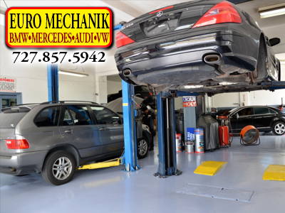 Photo of a Mercedes on a lift in very lean shop with Euro Mechanik Logo